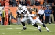 Sep 23, 2013; Denver, CO, USA; Oakland Raiders fullback Marcel Reece (45) runs after a reception as he is defended by Denver Broncos linebacker Nate Irving (56) in the fourth quarter at Sports Authority Field at Mile High. The Broncos defeated the Raiders 37-21. Mandatory Credit: Ron Chenoy-USA TODAY Sports