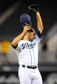 Sep 23, 2013; San Diego, CA, USA; San Diego Padres relief pitcher Huston Street (16) wipes his face after recording the second out during the ninth inning against the Arizona Diamondbacks at Petco Park. Mandatory Credit: Christopher Hanewinckel-USA TODAY Sports