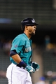 Sep 23, 2013; Seattle, WA, USA; Seattle Mariners pinch hitter Franklin Gutierrez (21) heads towards home plate after hitting a solo home run against the Kansas City Royals during the 8th inning at Safeco Field. Mandatory Credit: Steven Bisig-USA TODAY Sports