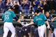 Sep 23, 2013; Seattle, WA, USA; Seattle Mariners pinch hitter Michael Saunders (55) and Seattle Mariners catcher Mike Zunino (3) celebrate after Saunders hit a solo home run against the Kansas City Royals during the 8th inning at Safeco Field. Mandatory Credit: Steven Bisig-USA TODAY Sports