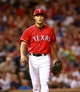 Sep 24, 2013; Arlington, TX, USA; Texas Rangers starting pitcher Yu Darvish (11) reacts to striking out a Houston Astros batter in the fifth inning of the game at Rangers Ballpark in Arlington. Mandatory Credit: Tim Heitman-USA TODAY Sports