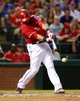 Sep 24, 2013; Arlington, TX, USA; Texas Rangers catcher Geovany Soto (8) hits a run scoring single in the fourth inning of the game against the Houston Astros at Rangers Ballpark in Arlington. Mandatory Credit: Tim Heitman-USA TODAY Sports