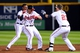 Sep 24, 2013; Atlanta, GA, USA; Atlanta Braves shortstop Andrelton Simmons (19) (center) reacts with B.J. Upton (2)  and Chris Johnson (23) after getting the game hit against the Milwaukee Brewers during the ninth inning at Turner Field. The Braves defeated the Brewers 3-2. Mandatory Credit: Dale Zanine-USA TODAY Sports