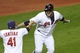 Sep 24, 2013; Cleveland, OH, USA; Cleveland Indians pinch hitter Jason Giambi (right) celebrates his game-winning two-run home run in the ninth inning against the Chicago White Sox at Progressive Field. Cleveland won 5-4. Mandatory Credit: David Richard-USA TODAY Sports