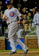 Sep 24, 2013; Chicago, IL, USA;  Chicago Cubs infielder Logan Watson scores against the Pittsburgh Pirates at Wrigley Field. Mandatory Credit: Matt Marton-USA TODAY Sports