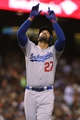 Sep 24, 2013; San Francisco, CA, USA; Los Angeles Dodgers center fielder Matt Kemp (27) celebrates pointing to the sky after hitting a solo home run against the San Francisco Giants during the sixth inning at AT&T Park. Mandatory Credit: Kelley L Cox-USA TODAY Sports