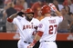 Sep 24, 2013; Anaheim, CA, USA; Los Angeles Angels second baseman Howie Kendrick (47) celebrates with designated hitter Mike Trout (27) after hitting a solo home run in the first inning against the Oakland Athletics at Angel Stadium of Anaheim. Mandatory Credit: Kirby Lee-USA TODAY Sports