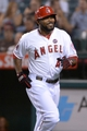Sep 24, 2013; Anaheim, CA, USA; Los Angeles Angels second baseman Howie Kendrick (47) reacts after hitting a solo home run in the first inning against the Oakland Athletics at Angel Stadium of Anaheim. Mandatory Credit: Kirby Lee-USA TODAY Sports