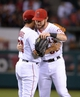 Sep 24, 2013; Anaheim, CA, USA; Los Angeles Angels pitcher Jason Vargas (56) and center fielder Josh Hamilton (32) embrace at the end of the game against the Oakland Athletics at Angel Stadium of Anaheim. The Angels defeated the Athletics 3-0. Mandatory Credit: Kirby Lee-USA TODAY Sports
