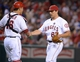 Sep 24, 2013; Anaheim, CA, USA; Los Angeles Angels pitcher Jason Vargas (60) and catcher Hank Conger (16) shake hands at the end of the game against the Oakland Athletics at Angel Stadium of Anaheim. The Angels defeated the Athletics 3-0. Mandatory Credit: Kirby Lee-USA TODAY Sports