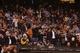 Sep 24, 2013; San Francisco, CA, USA; San Francisco Giants take photos with their phones as Los Angeles Dodgers relief pitcher Brian Wilson (not pictured) enters the game during the eighth inning at AT&T Park. Mandatory Credit: Kelley L Cox-USA TODAY Sports
