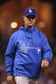 Sep 24, 2013; San Francisco, CA, USA; Los Angeles Dodgers manager Don Mattingly (8) returns to the dugout after replacing the pitcher against the San Francisco Giants during the eighth inning at AT&T Park. Mandatory Credit: Kelley L Cox-USA TODAY Sports