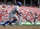Sep 25, 2013; Cincinnati, OH, USA; New York Mets left fielder Eric Young runs to first after hitting an RBI single against Cincinnati Reds starting pitcher Mat Latos in the third inning at Great American Ball Park. Mandatory Credit: David Kohl-USA TODAY Sports