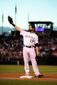 Sep 25, 2013; Denver, CO, USA; Colorado Rockies first baseman Todd Helton (17) reacts as he steps on first base before the start of the game against the Boston Red Sox at Coors Field. Mandatory Credit: Ron Chenoy-USA TODAY Sports