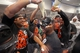 Sep 25, 2013; Minneapolis, MN, USA; Detroit Tigers relief pitcher Al Alburquerque (62) gets champagne dropped on him during a celebration of winning the American League Central Division Championship at Target Field. The Tigers won 1-0. Mandatory Credit: Jesse Johnson-USA TODAY Sports