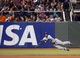Sep 25, 2013; San Francisco, CA, USA; Los Angeles Dodgers right fielder Yasiel Puig (66) dives for the ball during the sixth inning of the game against the San Francisco Giants at AT&T Park. Mandatory Credit: Ed Szczepanski-USA TODAY Sports