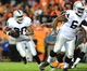 Sep 23, 2013; Denver, CO, USA; Oakland Raiders running back Darren McFadden (20) runs with the ball as guard Andre Gurode (64) blocks during the second half against the Denver Broncos at Sports Authority Field at Mile High.  The Broncos won 37-21. Mandatory Credit: Chris Humphreys-USA TODAY Sports