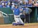 Sep 21, 2013; Kansas City, MO, USA; Texas Rangers catcher A.J. Pierzynski (12) makes a throw against the Kansas City Royals during the fourth inning at Kauffman Stadium. Mandatory Credit: Peter G. Aiken-USA TODAY Sports