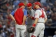 Sep 26, 2013; Atlanta, GA, USA; Philadelphia Phillies pitching coach Rich Dubee (30) talks to starting pitcher Tyler Cloyd (50) and catcher Erik Kratz (31) against the Atlanta Braves in the first inning at Turner Field. Mandatory Credit: Brett Davis-USA TODAY Sports
