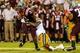 Sep 26, 2013; Atlanta, GA, USA; Virginia Tech Hokies quarterback Logan Thomas (3) is tackled by Georgia Tech Yellow Jackets defensive end Jeremiah Attaochu (45) in the first half at Bobby Dodd Stadium. Mandatory Credit: Daniel Shirey-USA TODAY Sports