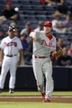 Sep 26, 2013; Atlanta, GA, USA; Philadelphia Phillies third baseman Cody Asche (25) throws a runner out at first against the Atlanta Braves in the eighth inning at Turner Field. Mandatory Credit: Brett Davis-USA TODAY Sports