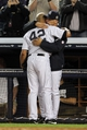 Sep 26, 2013; Bronx, NY, USA; New York Yankees relief pitcher Mariano Rivera (42) hugs manager Joe Girardi (28) after being removed from his final home game against the Tampa Bay Rays at Yankee Stadium. Mandatory Credit: Brad Penner-USA TODAY Sports