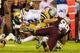 Sep 26, 2013; Atlanta, GA, USA; Georgia Tech Yellow Jackets quarterback Vad Lee (2) is tackled by Virginia Tech Hokies defensive tackle Derrick Hopkins (98) on a run in the second half at Bobby Dodd Stadium. Virginia Tech won 17-10. Mandatory Credit: Daniel Shirey-USA TODAY Sports