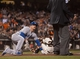 Sep 26, 2013; San Francisco, CA, USA; Los Angeles Dodgers catcher Tim Federowicz (18) looks to umpire Tim McClelland (36) for the call after sliding into home plate during the second inning at AT&T Park. Mandatory Credit: Ed Szczepanski-USA TODAY Sports
