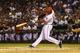 Sep 26, 2013; Arlington, TX, USA; Texas Rangers second baseman Jurickson Profar (13) hits a walk off home run during the ninth inning against the Los Angeles Angels at Rangers Ballpark in Arlington. Mandatory Credit: Kevin Jairaj-USA TODAY Sports