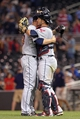 Sep 26, 2013; Minneapolis, MN, USA; Cleveland Indians relief pitcher Joe Smith (38) celebrates with catcher Yan Gomes (10) after beating the Minnesota Twins at Target Field. The Indians won 6-5. Mandatory Credit: Jesse Johnson-USA TODAY Sports