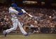 Sep 26, 2013; San Francisco, CA, USA; Los Angeles Dodgers second baseman Mark Ellis (14) hits an rbi double against the San Francisco Giants during the fourth inning at AT&T Park. The San Francisco Giants defeated the Los Angeles Dodgers 3-2. Mandatory Credit: Ed Szczepanski-USA TODAY Sports
