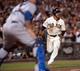 Sep 26, 2013; San Francisco, CA, USA; San Francisco Giants center fielder Gregor Blanco (7) looks for the relay throw while running home during the fifth inning of the game against the Los Angeles Dodgers at AT&T Park. The San Francisco Giants defeated the Los Angeles Dodgers 3-2. Mandatory Credit: Ed Szczepanski-USA TODAY Sports