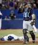 Sep 27, 2013; Toronto, Ontario, CAN; Toronto Blue Jays second baseman  Ryan Goins (17) lies at home plate after being tagged out by Tampa Bay Rays catcher Jose Lobaton (59) in the fourth inning at Rogers Centre. Mandatory Credit: John E. Sokolowski-USA TODAY Sports