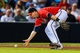 Sep 27, 2013; Atlanta, GA, USA; Atlanta Braves third baseman Chris Johnson (23) fields a ground ball in the sixth inning against the Philadelphia Phillies at Turner Field. Mandatory Credit: Daniel Shirey-USA TODAY Sports