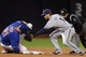 Sep 27, 2013; New York, NY, USA; New York Mets left fielder Lucas Duda (21) slides safely into second base before being tagged by Milwaukee Brewers shortstop Jeff Bianchi (14) during the third inning at Citi Field. Mandatory Credit: Brad Penner-USA TODAY Sports