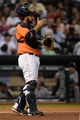 Sep 27, 2013; Houston, TX, USA; Houston Astros catcher Carlos Corporan (22) signals to the infield against the New York Yankees during the fourth inning at Minute Maid Park. Mandatory Credit: Thomas Campbell-USA TODAY Sports