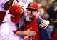 Sep 27, 2013; St. Louis, MO, USA; St. Louis Cardinals first baseman Allen Craig (21) gets a hug from right fielder Shane Robinson (43) during the game against the Chicago Cubs at Busch Stadium. Craig is on the disabled list with an ankle injury. Mandatory Credit: Scott Rovak-USA TODAY Sports