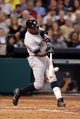 Sep 27, 2013; Houston, TX, USA; New York Yankees left fielder Alfonso Soriano (12) hits a ground rule double against the Houston Astros during the sixth inning at Minute Maid Park. Mandatory Credit: Thomas Campbell-USA TODAY Sports