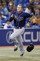 Sep 27, 2013; Toronto, Ontario, CAN; Tampa Bay Rays third baseman Evan Longoria (3) scores in the ninth inning against the Toronto Blue Jays at Rogers Centre. Toronto defeated Tampa Bay 6-3. Mandatory Credit: John E. Sokolowski-USA TODAY Sports