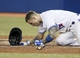 Sep 27, 2013; Toronto, Ontario, CAN; Toronto Blue Jays third baseman Brett Lawrie (13) gets up after being hit by a Tampa Bay Rays pitch in the seventh inning at Rogers Centre. Toronto defeated Tampa Bay 6-3. Mandatory Credit: John E. Sokolowski-USA TODAY Sports