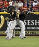 Sep 27, 2013; Cincinnati, OH, USA; Pittsburgh Pirates center fielder Andrew McCutchen (left), left fielder Starling Marte (center), and Pittsburgh Pirates right fielder Marlon Byrd (right) celebrate after the Pirates beat the Cincinnati Reds 4-1at Great American Ball Park. Mandatory Credit: David Kohl-USA TODAY Sports
