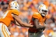 Sep 28, 2013; Knoxville, TN, USA; Tennessee Volunteers quarterback Justin Worley (14) hands the ball off to running back Rajion Neal (20) against the South Alabama Jaguars during the second half at Neyland Stadium. Tennessee won 31 to 24. Mandatory Credit: Randy Sartin-USA TODAY Sports