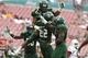 Sep 28, 2013; Tampa, FL, USA; South Florida Bulls defensive back Hassan Childs (22) is congratulated by teammates after he intercepted the ball during the second half against the Miami Hurricanes at Raymond James Stadium. Miami Hurricanes defeated the South Florida Bulls 49-21. Mandatory Credit: Kim Klement-USA TODAY Sports