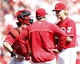 Sep 28, 2013; Cincinnati, OH, USA; Cincinnati Reds pitching coach Bryan Price (center) talks to starting pitcher Bronson Arroyo (61) and catcher Ryan Hanigan (29) during the third inning against the Pittsburgh Pirates at Great American Ball Park. Mandatory Credit: Frank Victores-USA TODAY Sports