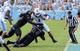 Sep 28, 2013; Chapel Hill, NC, USA; North Carolina Tarheels running back Khris Francis (1) is tackled by East Carolina Pirates linebacker Brandon Williams (24) during the second half at Kenan Memorial Stadium.  ECU won 55-31. Mandatory Credit: Rob Kinnan-USA TODAY Sports