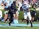 Sep 28, 2013; Chapel Hill, NC, USA; North Carolina Tarheels receiver Quinshad Davis (14) runs for a touchdown as East Carolina Pirates defensive back Josh Hawkins (28) pursues during the second half at Kenan Memorial Stadium.  ECU won 55-31. Mandatory Credit: Rob Kinnan-USA TODAY Sports