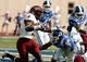 Sep 28, 2013; Durham, NC, USA;  Troy Trojans wide receiver Eric Thomas (3) runs the ball against Duke Blue Devils safety Jeremy Cash (16) at Wallace Wade Stadium. Mandatory Credit: Mark Dolejs-USA TODAY Sports