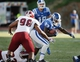Sep 28, 2013; Durham, NC, USA;  Troy Trojans defensive tackle Lonnie Gosha (98) defends as Duke Blue Devils running back Juwan Thompson (23) runs the ball at Wallace Wade Stadium. Mandatory Credit: Mark Dolejs-USA TODAY Sports