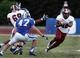Sep 28, 2013; Durham, NC, USA;  Duke Blue Devils linebacker David Helton (47) defends as Troy Trojans running back Brandon Burks (32) runs the ball at Wallace Wade Stadium. Mandatory Credit: Mark Dolejs-USA TODAY Sports
