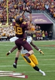 Sep 28, 2013; Minneapolis, MN, USA; Minnesota Golden Gophers wide receiver Derrick Engel (18) catches a pass for a touchdown over Iowa Hawkeyes quarterback Cody Sokol (19) in the second half at TCF Bank Stadium. The Hawkeyes won 23-7. Mandatory Credit: Jesse Johnson-USA TODAY Sports